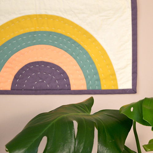 Rainbow quilted wall hanging