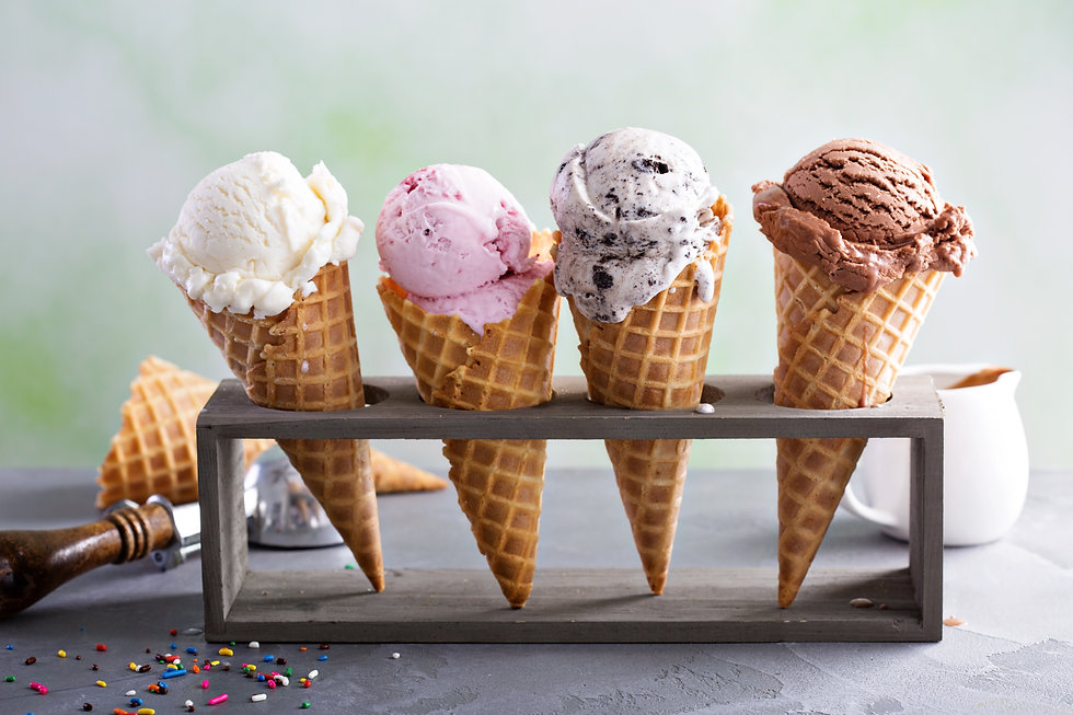 Variety of ice cream scoops in cones wit
