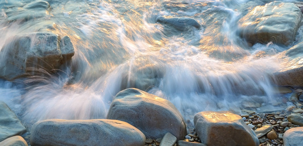 abstract image of water flowing over roc