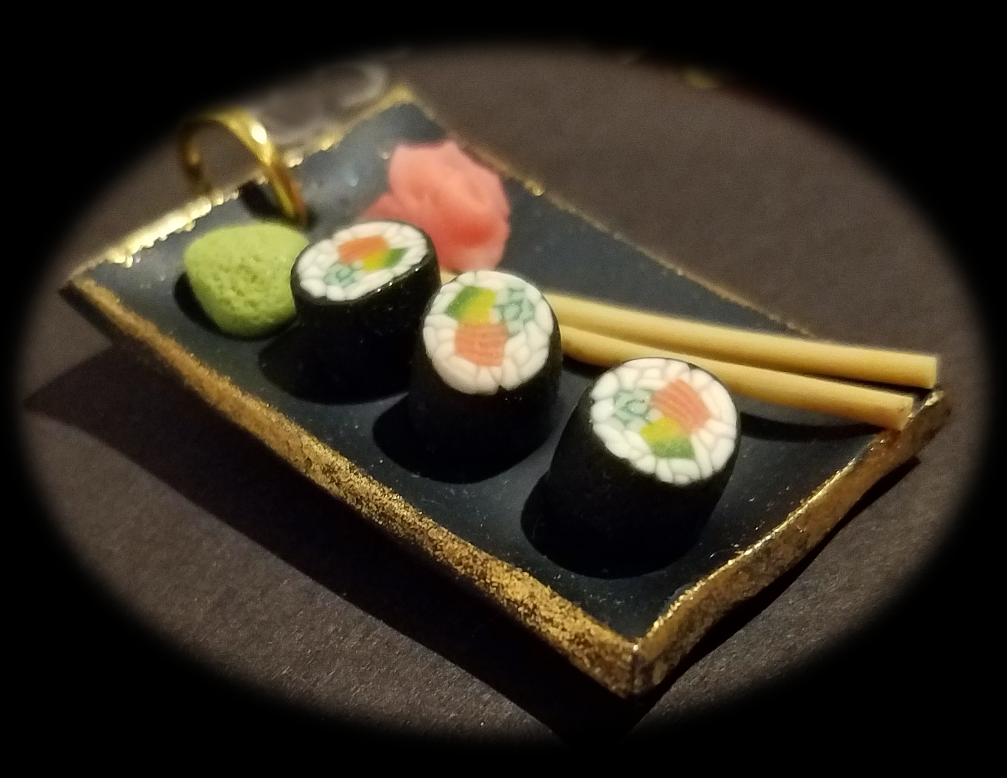 Sushi on Dark gilded Platter