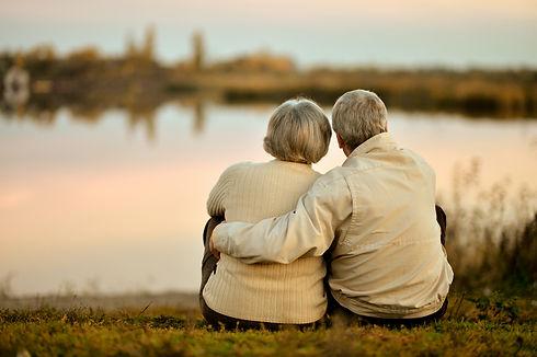 Happy senior couple sitting in summer ne