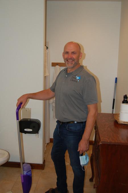 Jim cleaning bathroom