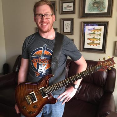 Andrew Guitar Smile.jpg