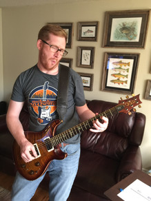 Andrew Guitar Funny Face.jpg