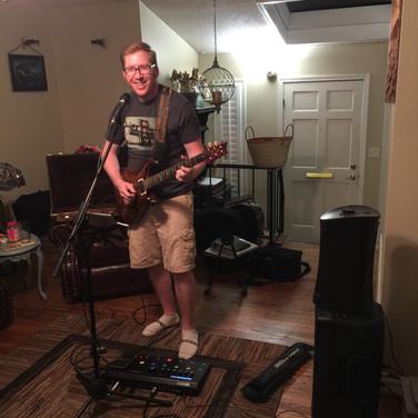 Andrew Guitar Living Room.jpg