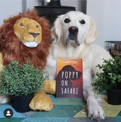 Poppy's furriend, Iris, enjoying her book