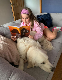 Isabelle reading her book to Poppy