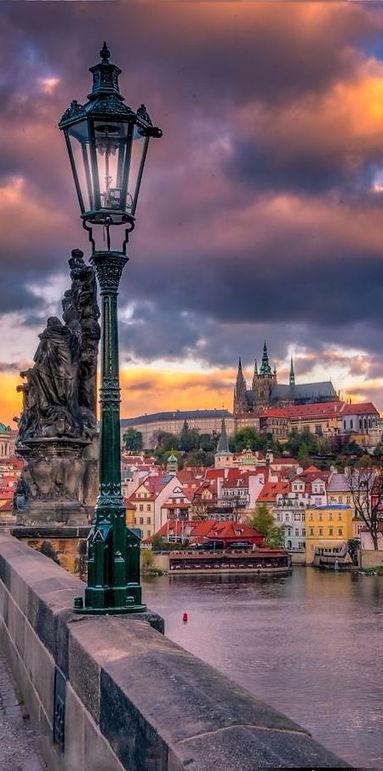 Sunset over Prague castle from Charles bridge, Czechia