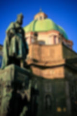 The emperor Charles IV statue and St.Franciscus of Assisi church in Prague, Czechia