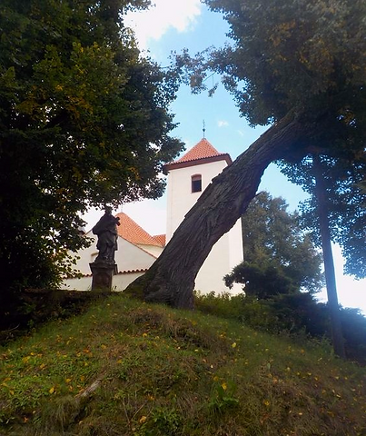 Typical scenery of Centr.Bohemian village- the church, statue of St.John of Nepomuk and linden trees - Libouň, Czechia