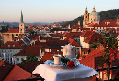 St.Thomas and St.Nicolas church from the terrace of Golden Well hotel, Prague, Czechia