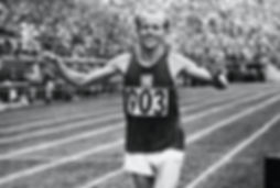 Emil Zátopek at the finish of marathon run in 1952 Helsinki Olympic Games
