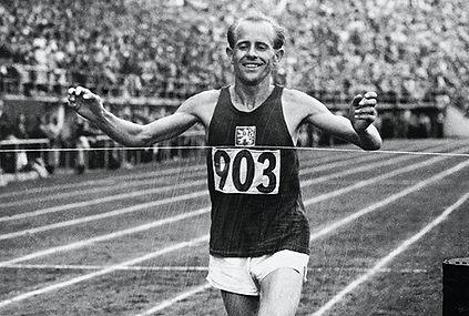 Emil Zátopek at the finish of marathon run in 1952 Helsinki Olympic Games