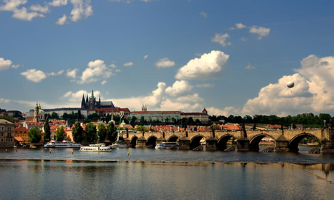 Prague castle with Charles bridge from right bank of Vltava river, Czechia