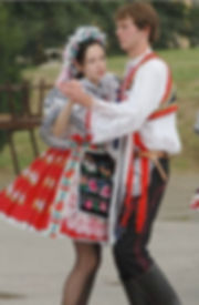 Dancing couple in South Moravian folk costumes - Czechia