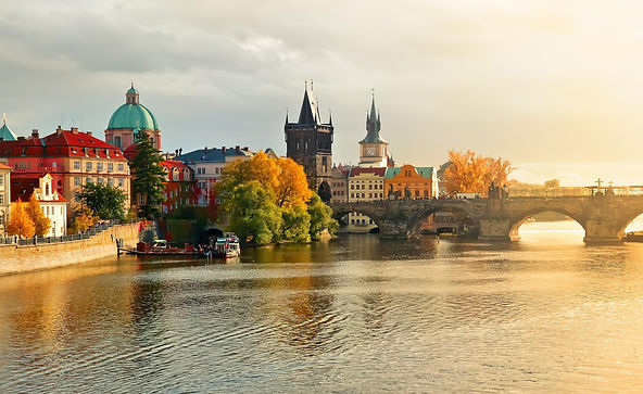 Charles bridge with Old Town tower, Old Water-tower and the church of St.Francis of Assisi, Prague, Czechia