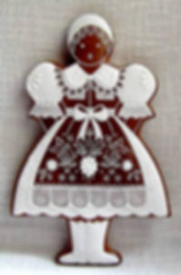 Gingerbread motifs - girl in folk costume - Czechia