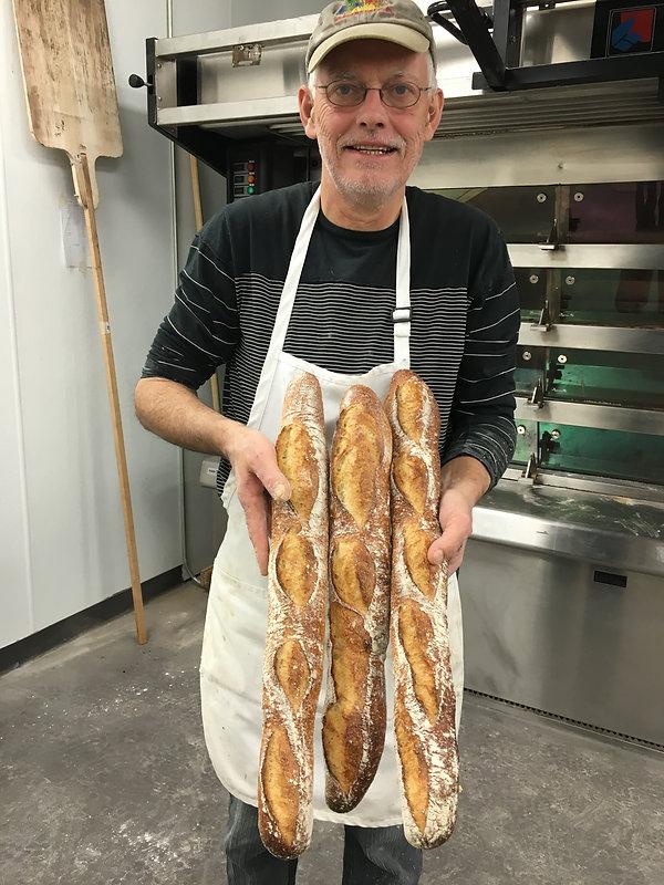Maurice Chaplais, Artisan Bread Consultant holding sour dough baguettes