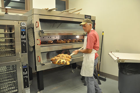 Maurice Chaplais Baking Industry Consultant unload oven at bakery in Port Washington USA