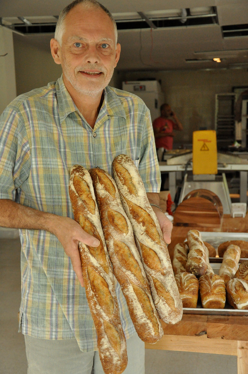 Maurice Chaplais Bakery Consulting Artisan Bread with his baguettes made with a levain and Poolish, at Holey Bakery Dhaka, Bangladesh