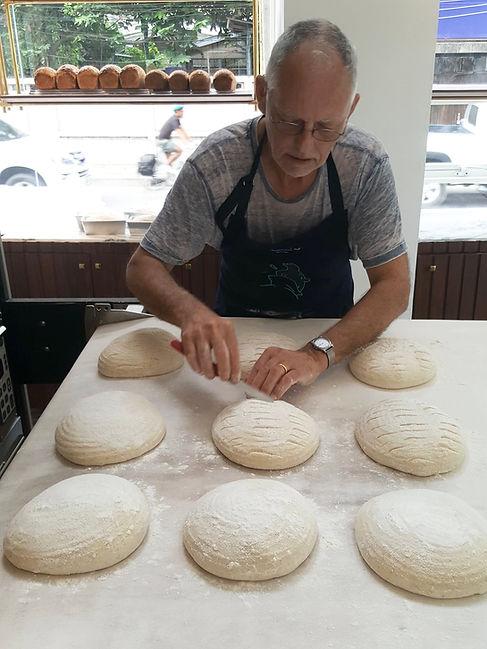 Maurice Chaplais Artisan Bread Consultant cutting Pain Au Levain