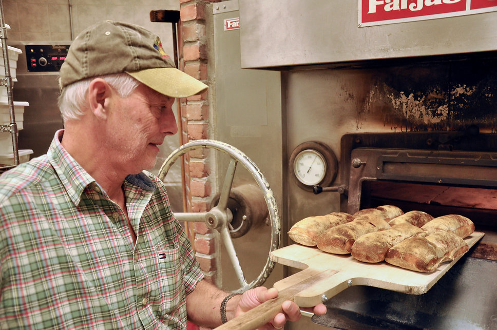 Maurice Chaplais Trainer in Bakery unloads oven at Holiday Markets, Canton, USA