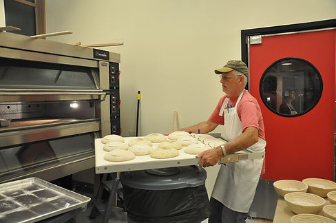 Maurice Chaplais Artisan Bread Consultant loads oven at Daily Baking Company, Port Washington, USA