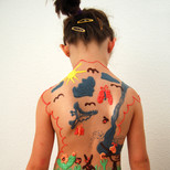 """Chocolate body painting """"Child's own drawing on her back"""""""