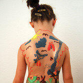 "Chocolate body painting ""Child's own drawing on her back"""