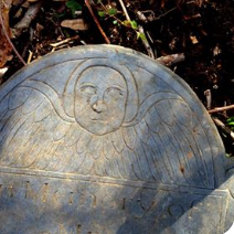 Closeup of Angel Carving on Joseph Simmons Stone