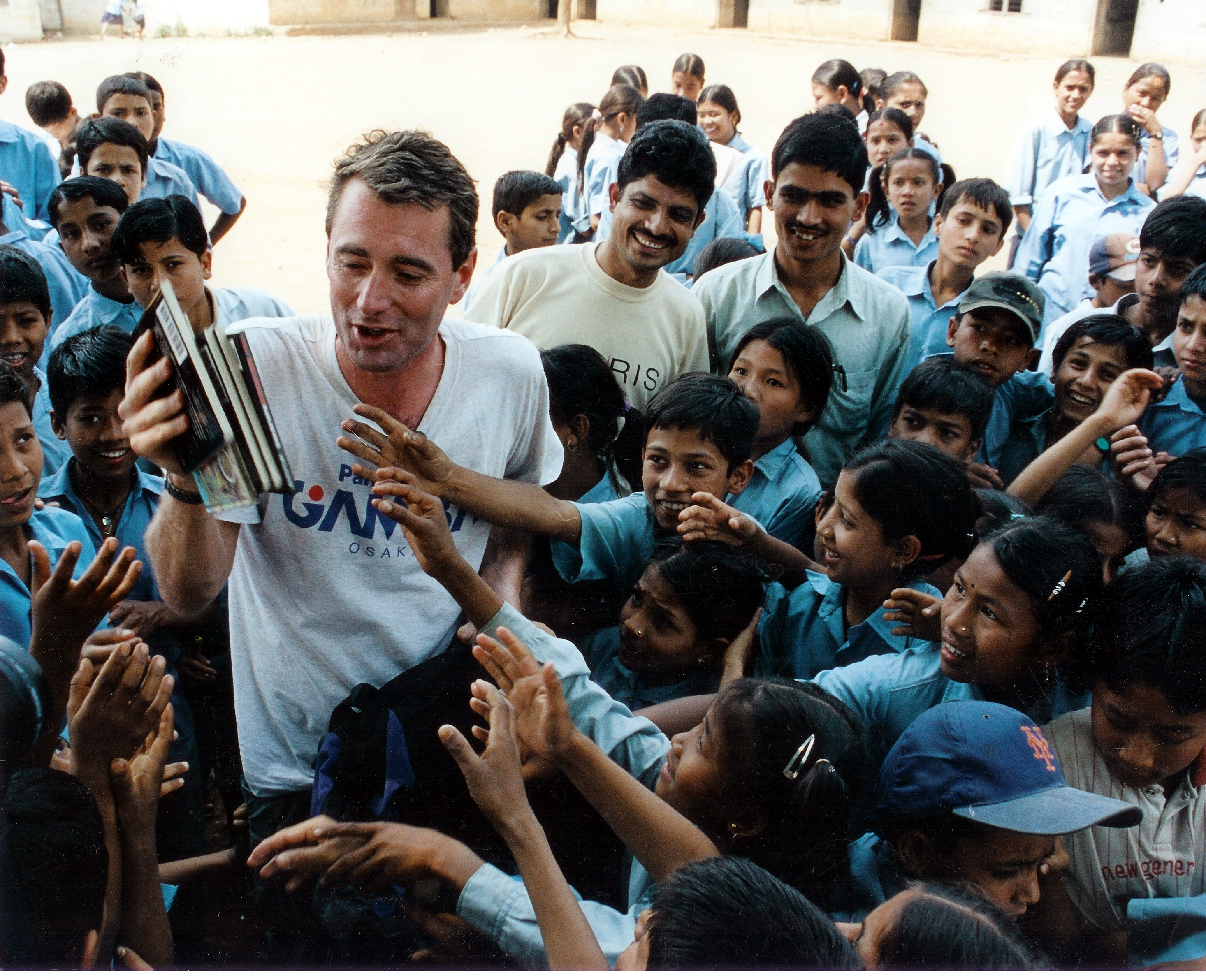 John Wood_distributing books in Nepal.jp