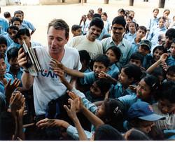 John Wood_distributing books in Nepal.jp