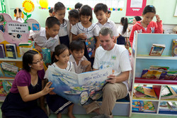 John Wood_reading to children in Vietnam