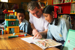 John Wood_reading with students in Nepal