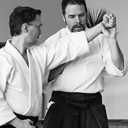 Holloway Sensei and D. Wood teach in class about striking principles.