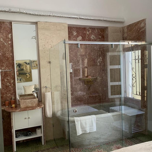 Room With Marble Bath, Shower and Sink