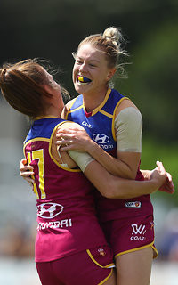 Kate McCarthy celebrates an important goal for the Lions