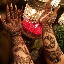 Intricate symbolic henna
