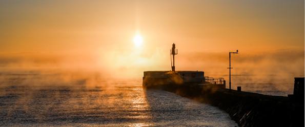 Burning mist over the pier