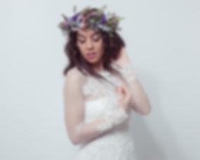 Bride holding orchids bouquet.jpg