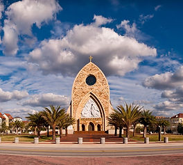 Church surrounded by modern buildings in Ave Maria Florida_edited_edited_edited.jpg