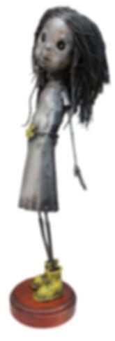 Pequeña con botas amarillas 60x20x15cm