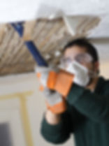 Male Fixing Ceiling man scraping plaster
