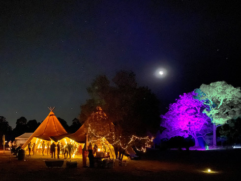 Tipis lit up and night