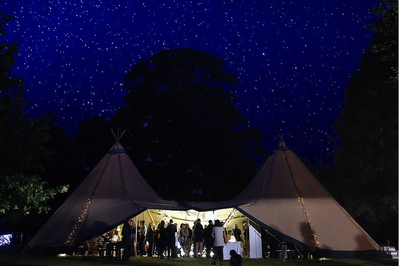 two kata tipis linked at night starry sky event