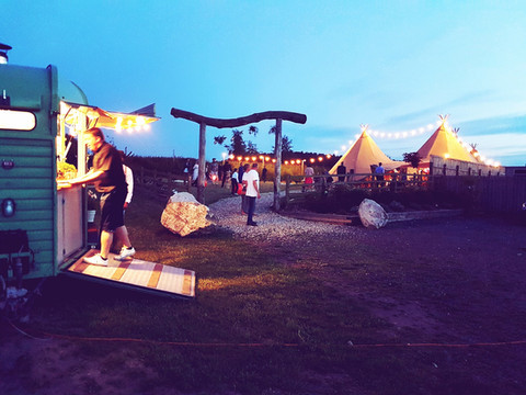 Tipis at night with food truck