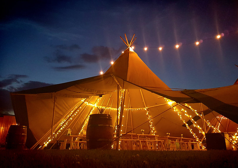 Tipi by night with fairy lights