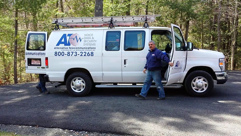 Photo of our phone techs coming out of our van