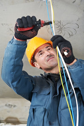 Photo of a technician cutting CAT5e cables