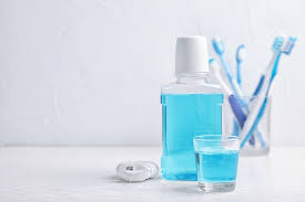 How does mouth wash help to improve oral health?